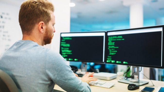 man-using-computer-insider-threat-monitoring-software-developer-675x380 7 Criteria for Choosing Best Insider Threat Monitoring System