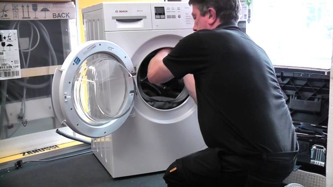technician-repairing-washing-machine-675x380 Top 10 Washing Machine Parts That Need Repair in Canada