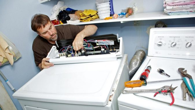 technician-washing-machine-repaire-675x380 Top 10 Washing Machine Parts That Need Repair in Canada