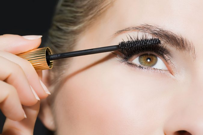 woman-applying-mascara-675x450 Top 10 Tricks to Remove Makeup Stains from Clothes Easily