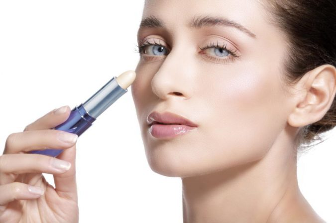 woman-applying-skin-concealer-675x449 7 Tricks to Keep Your Lipstick Last Longer