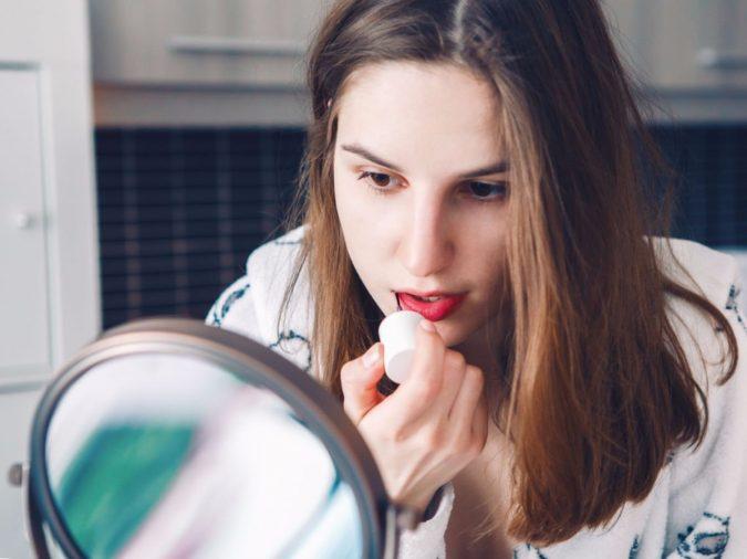 woman-makeup-applying-lipstick-675x506 7 Tricks to Keep Your Lipstick Last Longer