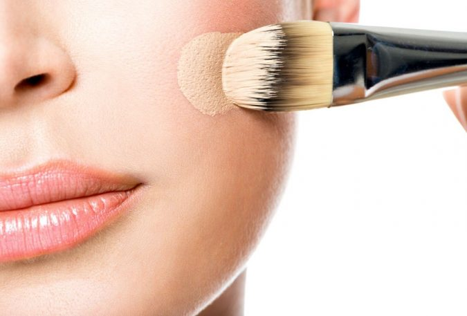 applying-makeup-foundation-with-brush-675x457 5 Simple Tips to Avoid Cakey Makeup