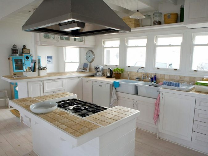 kitchen-with-Tiled-Countertops-675x506 10 Outdated Kitchen Trends to Avoid in 2020