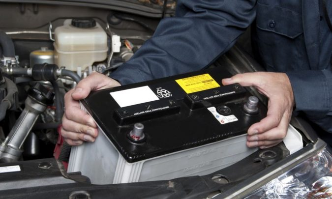 fix-car-changing-battery-675x405 What Car Issues You Can Fix with AutoZone Tool Rental