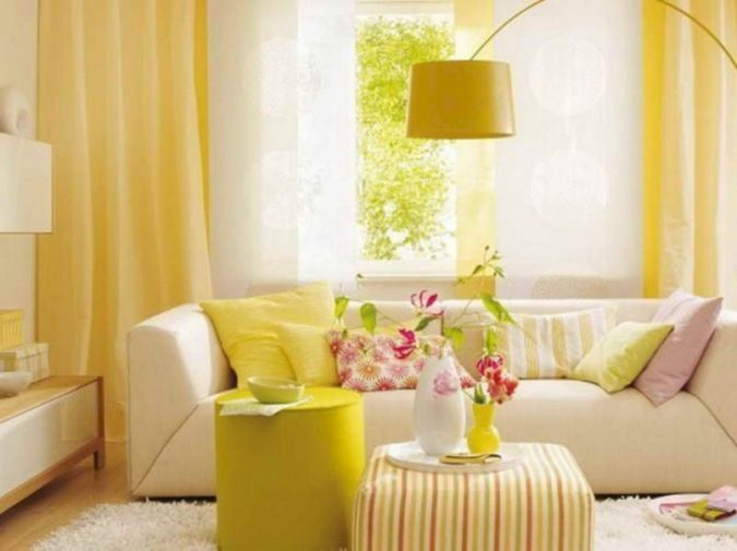 Yellow-Living-Room-Curtains-675x505 12 Ways to Keep Your House Warm in Winter