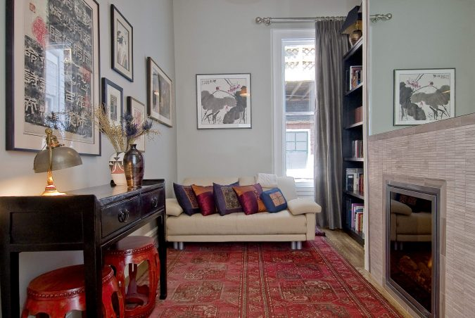 persian-carpet-on-wood-flooring-in-contemporary-living-room-675x452 12 Ways to Keep Your House Warm in Winter