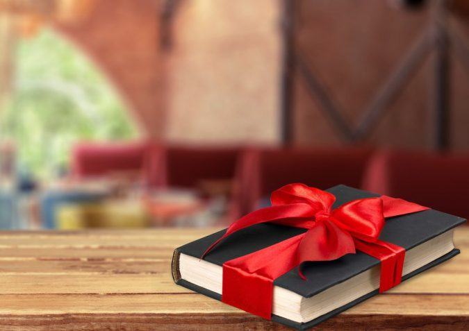 book-gift-corporate-gift-675x477 10 Branded Gifts & How They Build the Company's Reputation