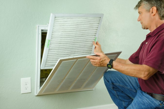 air-conditioner-filter-replacement-technician-maintenance-675x447 Fast Repairs for Leaking Central Air Conditioning Systems