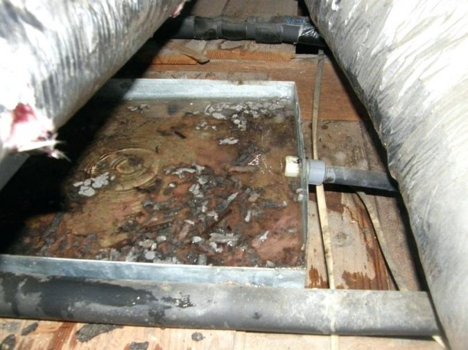 air-conditioner-rusted-condensation-drain-pan-675x506 Fast Repairs for Leaking Central Air Conditioning Systems