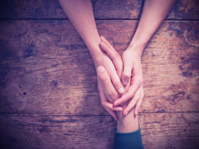 friends-holding-hands-help-friend-with-depression-675x506 8 Ways to Help a Friend with Depression