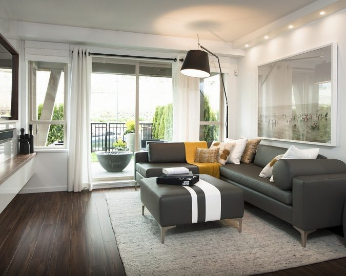 living-room-dark-wood-floor-home-decoration-675x539 10 Wood Floors Design Ideas for Living Rooms