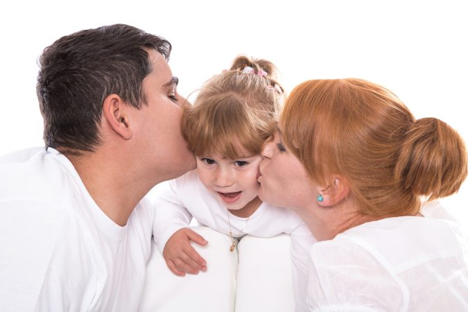 parents-kissing-daughter-coping-and-supporting-your-child-who-is-deaf-675x450 5 Things to Know about the Parent-Child Relationship