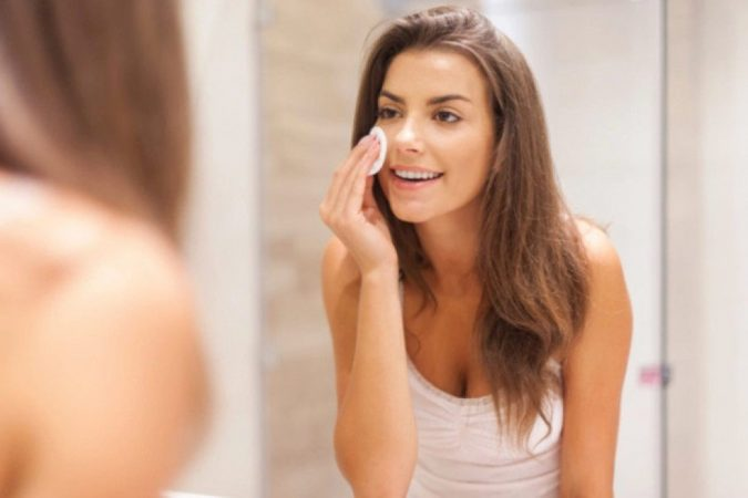 woman-applying-makeup-675x450 10 Tips to Hide Acne with Makeup