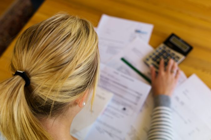 woman-calculating-Mental-Effects-of-Debt-shutterstock_180918242-675x449 When Debt and Money Meet Mind
