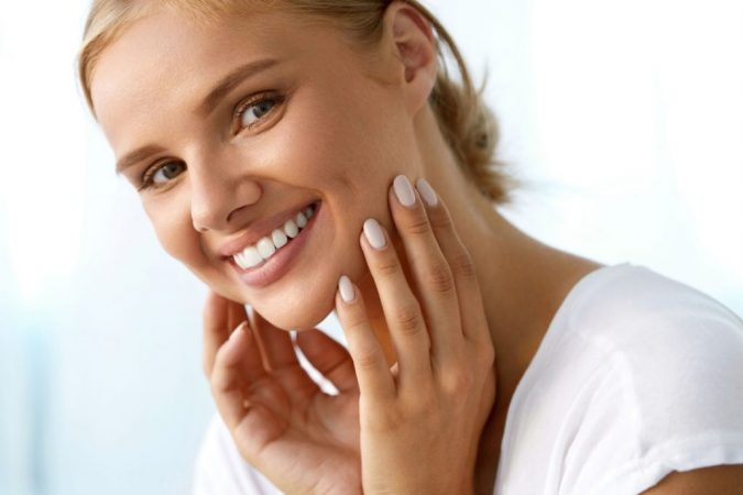 woman-smiling-remove-beauty-marks-675x450 Easiest 7 Ways to Get Rid of Beauty Marks