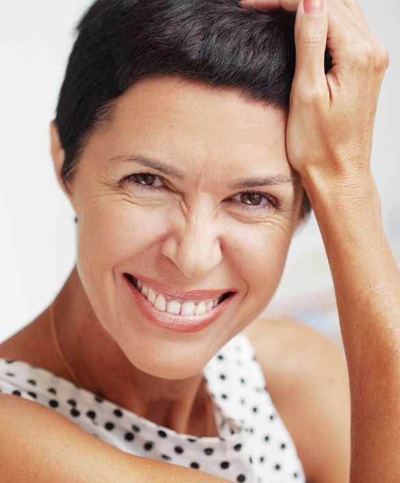 woman-smiling 10 Tips to Get Rid of Under Eye Lines and Wrinkles