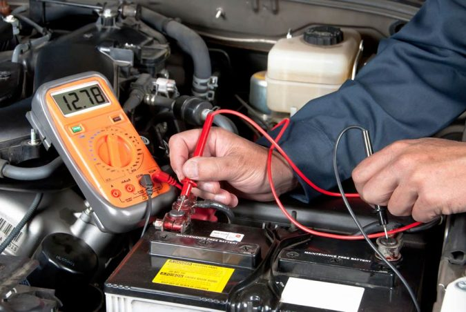 Chacking-the-Car-Battery-675x452 10 Essential Car Maintenance Tips That You Should Know
