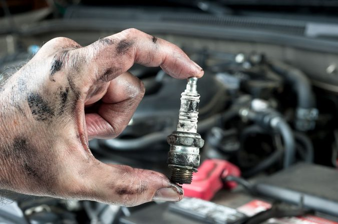 Change-car-Spark-Plugs-675x449 10 Essential Car Maintenance Tips That You Should Know