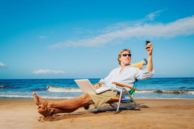 business-vacation-smartphone-beach-675x450 9 Ways Your Smartphone is Making Your Life Inferior