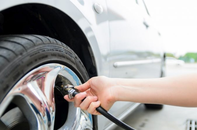 checking-the-car-Tires-2-675x447 10 Essential Car Maintenance Tips That You Should Know