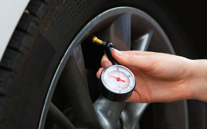 checking-the-car-Tires-675x422 10 Essential Car Maintenance Tips That You Should Know