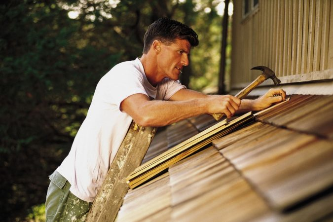 fixing-home-man-reparing-home-roof-DIY-675x450 How to Prep for a Successful Home Walk-Through with Ease