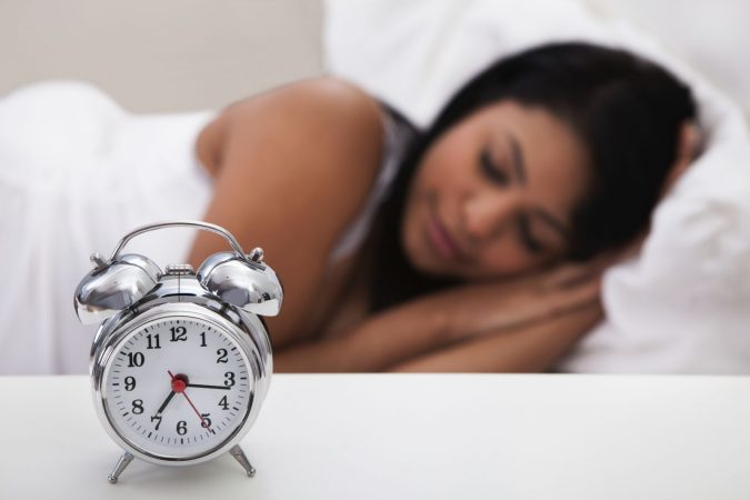 sleep-clock-sleeping-woman-675x450 Top 10 Ways to Relax if You Are a College Freshman