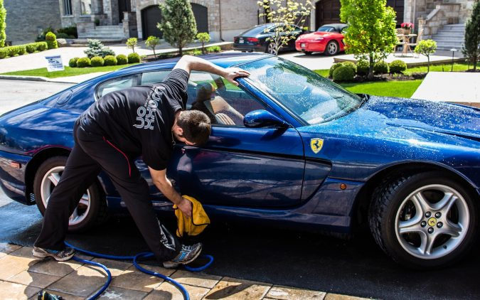 washing-a-car-2-675x422 10 Essential Car Maintenance Tips That You Should Know