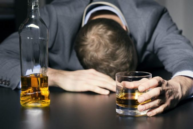 drinking-alcohol-Drunk-businessman-holding-a-glass-of-whiskey_0-675x450 Holistic Ways to Fight Stress and Find Peace