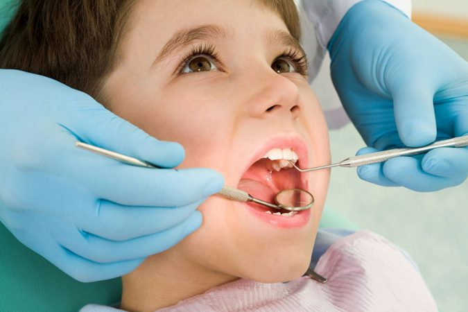 smiling-boy-gets-checkup-from-his-orthodontist-675x450 Debunking 7 Common Myths about Orthodontics