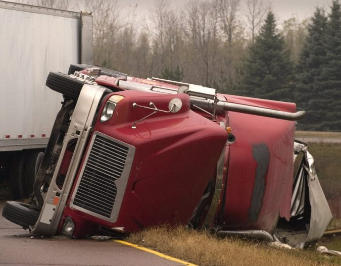 truck-accident-CommercialTruckFlippedOver-675x527 What Can a Semi Truck Accident Lawyer Do for You?