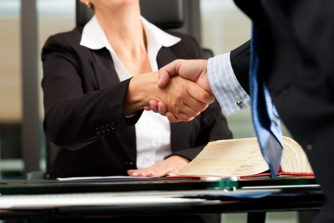lawyer-and-client-handshake-675x450 Should I Get an Attorney After a Car Accident?