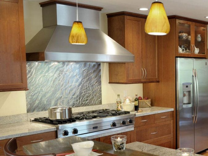 Modern-Stainless-Steel-Kitchen-Backsplash-675x507 10 Outdated Kitchen Trends to Substitute in 2019