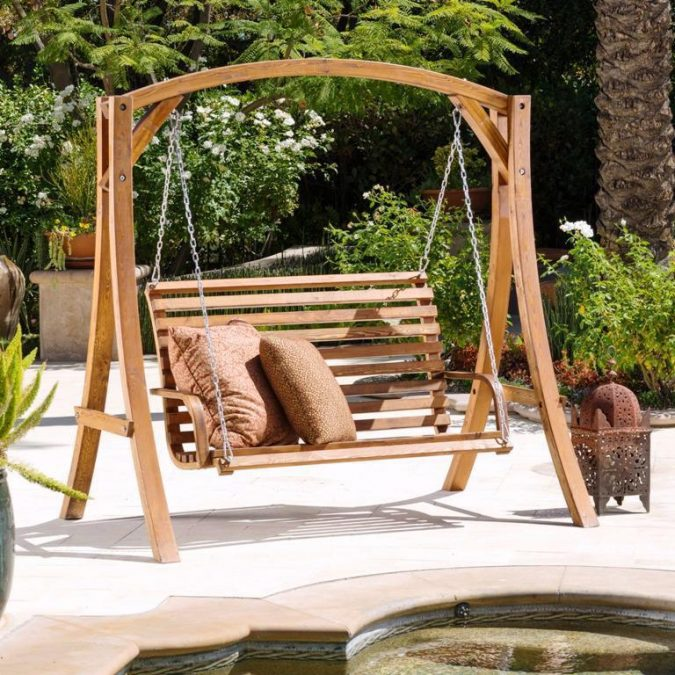 Wooden-Porch-Swing-at-Home-garden-675x675 +7 Ideas to Revamp Your Garden for 2020