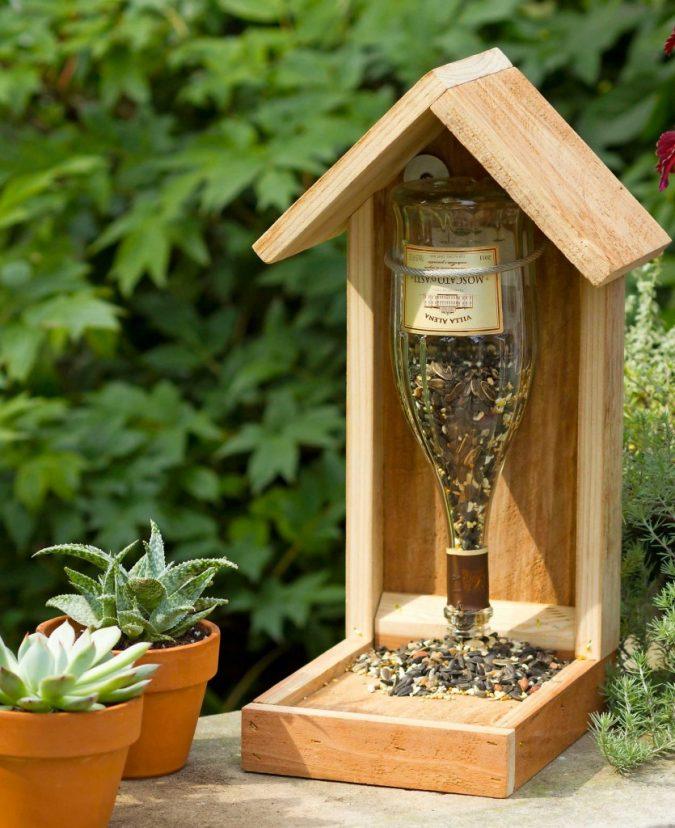 home-garden-bird-feeder-Upside-down-wine-bottle-bird-house-675x828 +7 Ideas to Revamp Your Garden for 2021