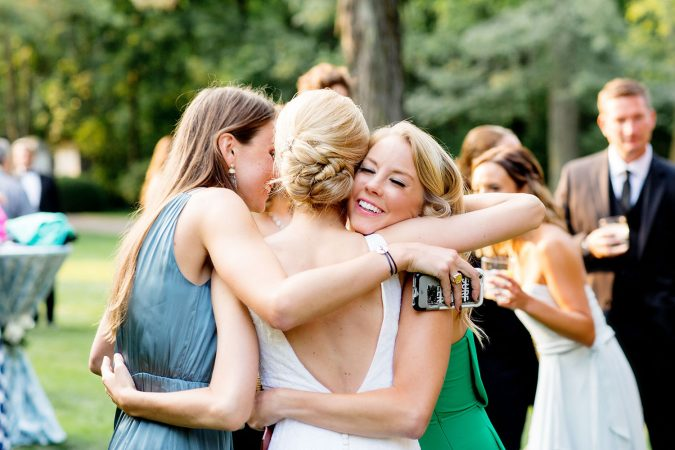 bride-hugging-friends-after-wedding-675x450 10 Outdated Wedding Trends to Avoid in 2019