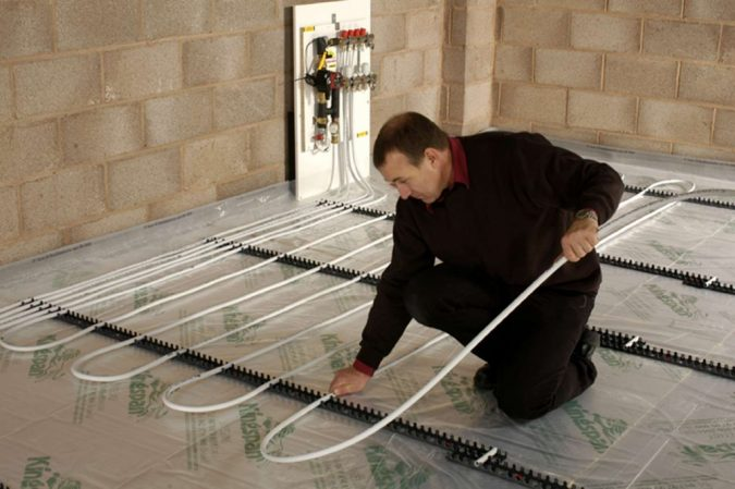 home-Installing-underfloor-heating-675x449 Underfloor Heating and Wood Flooring: What You Need to Know Before Installation