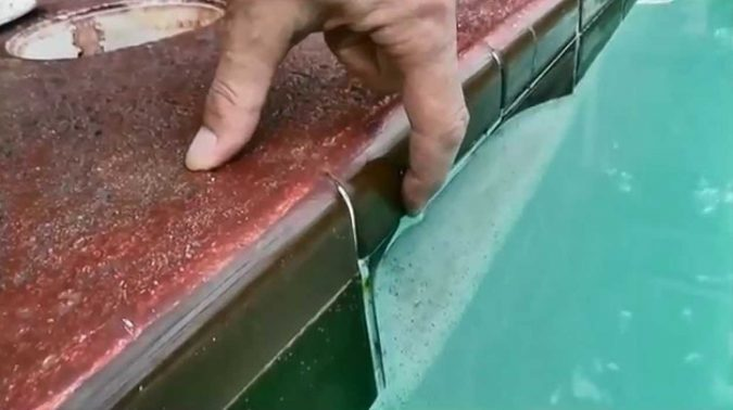 Checking-the-Water-Level-1-675x378 Top 15 Must-Follow Pool Maintenance Tips