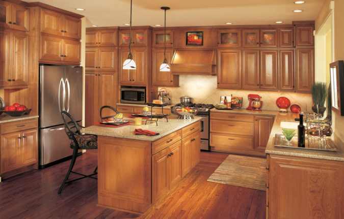 Wood-Cabinets-675x431 15 Outdated Home Decorating Trends Coming Back in 2019