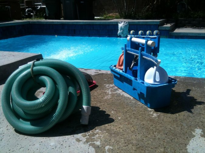pool-cleaning-675x506 Top 15 Must-Follow Pool Maintenance Tips