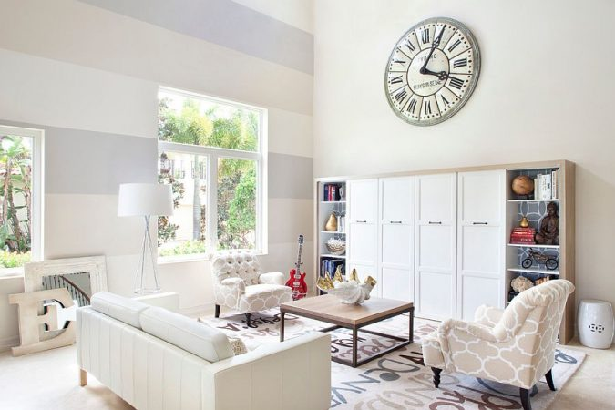 Serene-living-room-with-accent-striped-wall-675x450 Best 14 Tips to Follow When Planning a Small Living Room