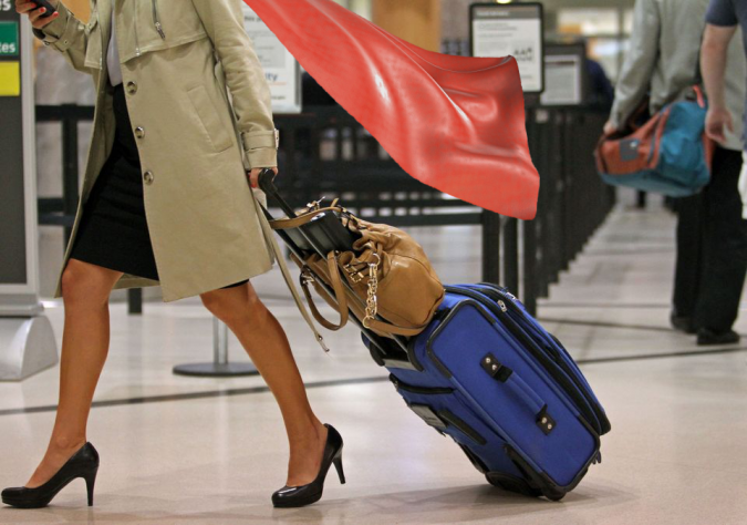 Woman-airport-travel-675x474 What Expats Should Know Before Returning Home