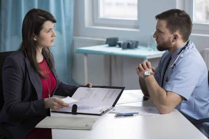 injury-lawyer-and-doctor-medical-records-675x450 What to Do after Suffering a Car Injury