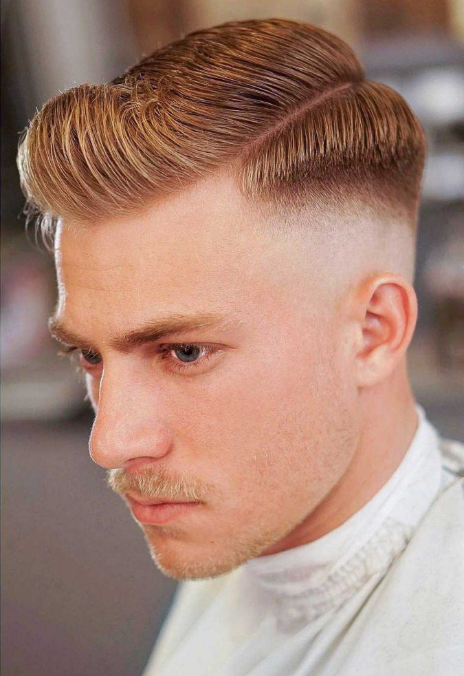 side-part-short-pompadour-with-middle-skin-fade-haircut-675x982 10 Best Men's Haircuts According to Face Shape in 2020