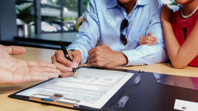 signing-car-warranty-675x380 What Are the Varying Levels of Vehicle Warranty and Which Is Best for You?