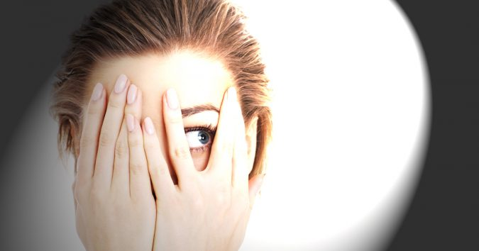 woman-covers-eye-bright-light-675x354 11 Facts about Colored Lenses that May Surprise You