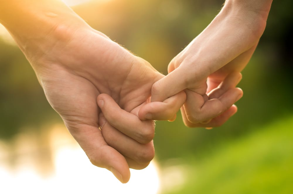 couple-holding-hands 5 Things to Consider When Choosing a Couples Marriage Retreat