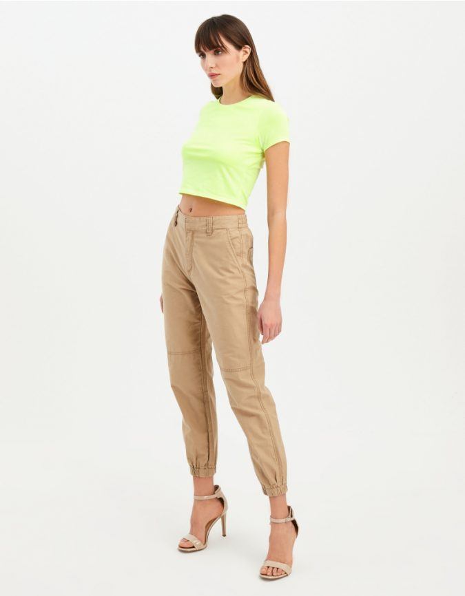 beige-trousers-neon-green-crop-top-summer-outfit-1-675x866 12 Fashion Trends of Summer and How to Style Them