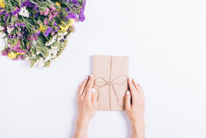 books-for-moms-wrapped-book-and-flowers-675x453 Top 15 Creative Mother's Day Gift Ideas